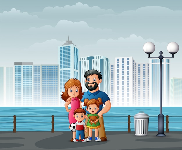 Happy family standing at the riverbank across the cities Premium Vector