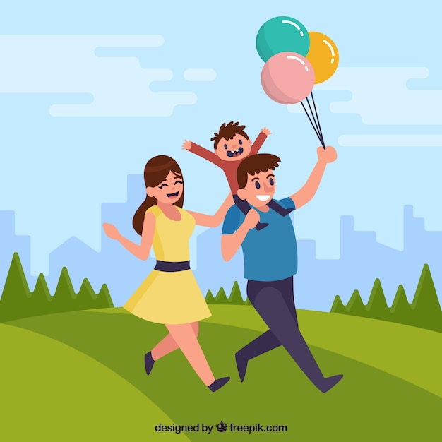 Happy family with balloons in the park