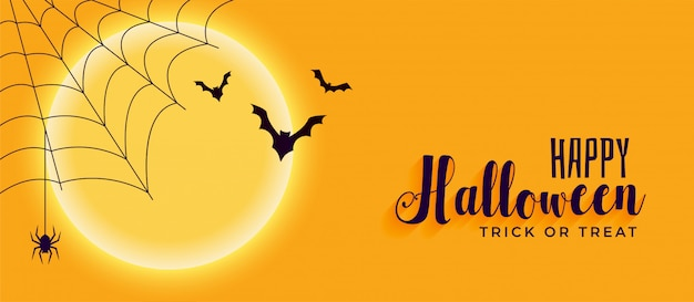Happy halloween banner with spider web and flying bats Free Vector