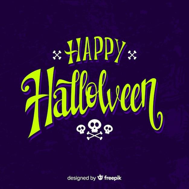 Happy halloween calligraphy with skulls Free Vector