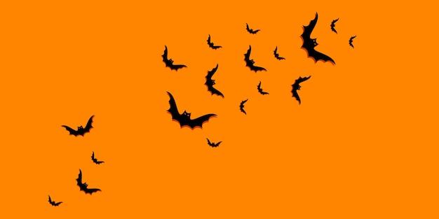 コピースペースと黒いコウモリと幸せなハロウィーンのグラデーションの背景。フラットレイ、上面図。最小限のコンセプト Premiumベクター