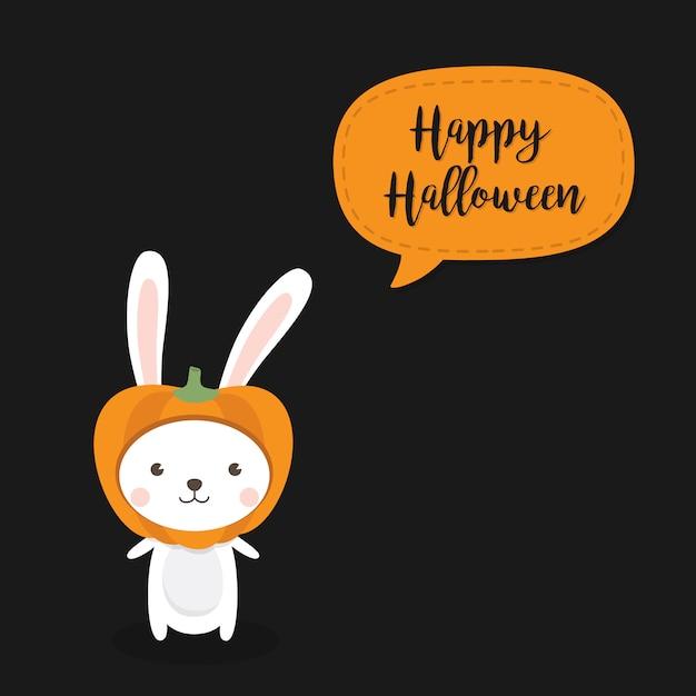 Счастливая поздравительная открытка хэллоуина с милой кошкой, носящей тыквенную шляпу. Premium векторы