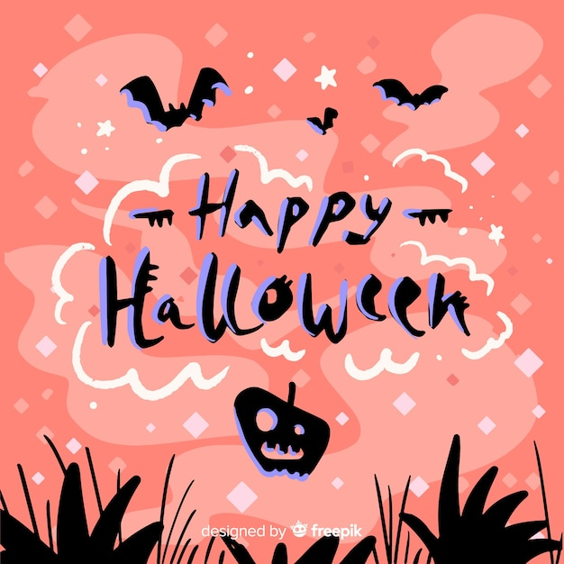 Happy halloween lettering with pink background Free Vector