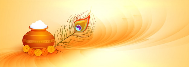 Happy janmashtami banner with dahi handi and peacock feather Free Vector