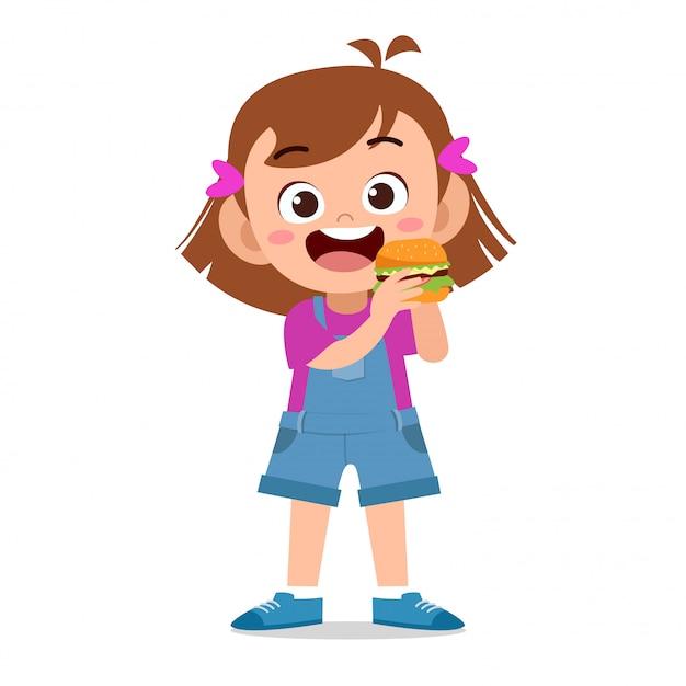 Happy kid eating Premium Vector