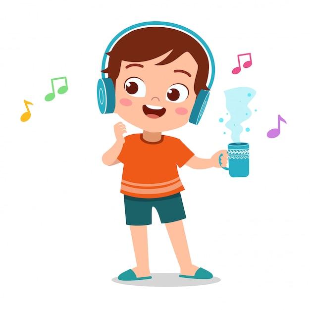 Happy kid listening music Premium Vector
