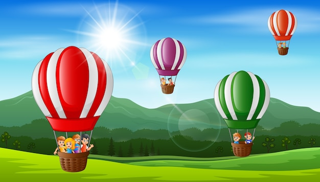 Happy kids flying in a hot air balloon Premium Vector