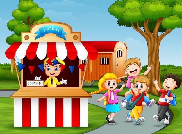 Happy kids having fun in an amusement park Premium Vector