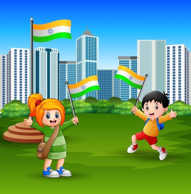 都市公園の国旗を保持している幸せな子供たち Premiumベクター