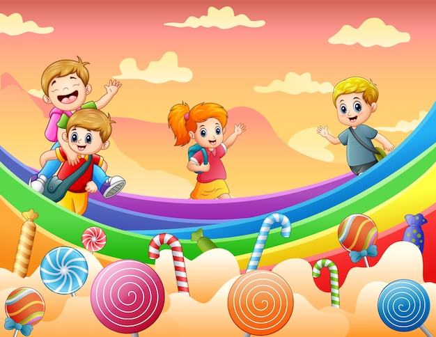 Happy kids playing on a candy land illustration Premium Vector