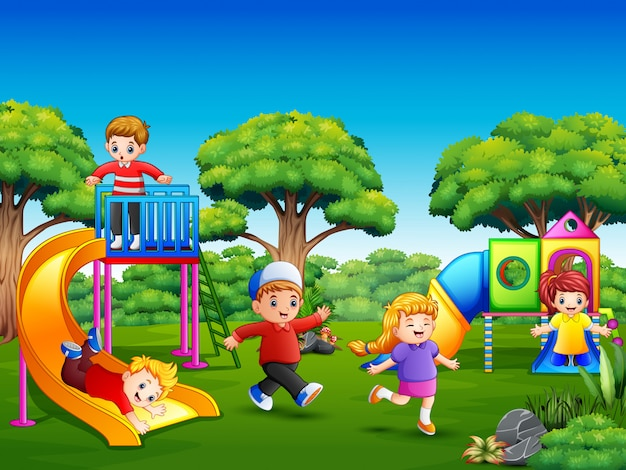 Happy kids playing on the playground Premium Vector