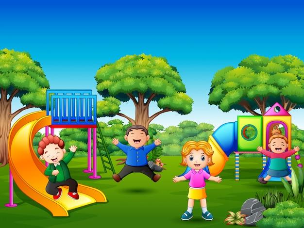 Happy kids playing on the playground Premium Vector