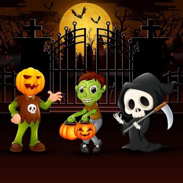 Happy kids wearing halloween costume outdoors at night Premium Vector