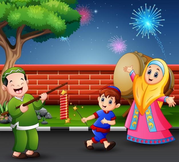 Happy muslim people celebrate for eid mubarak with firecracker Premium Vector