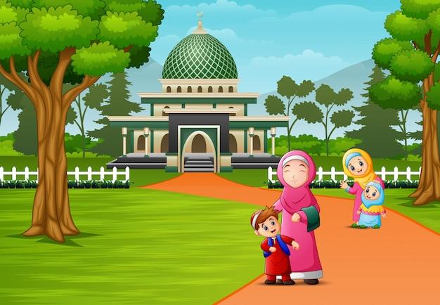 Happy muslim people posing in front of mosque Premium Vector
