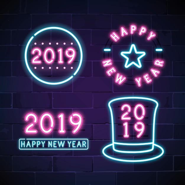 Happy new year 2019 neon sign vector set Free Vector