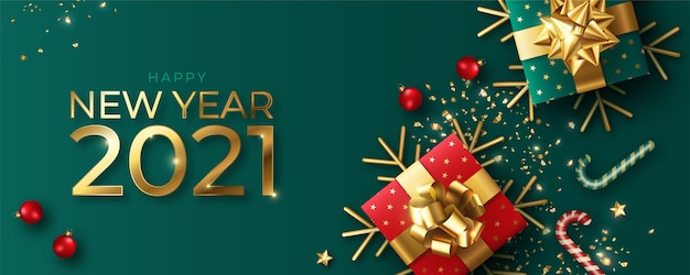 Banner realistico di felice anno nuovo con decorazioni rosse e verdi Vettore gratuito