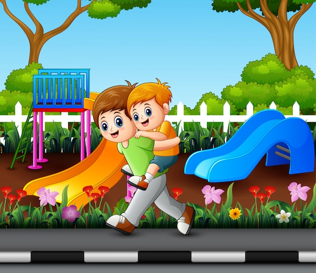 Happy older brother with his younger brother in the park Premium Vector