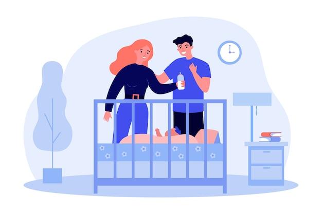 ベビーベッドで赤ちゃんを見ている幸せな親。 Premiumベクター