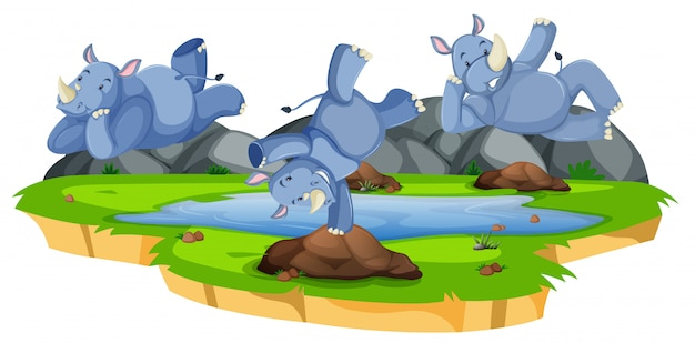 Happy rhinoceros character in nature Free Vector