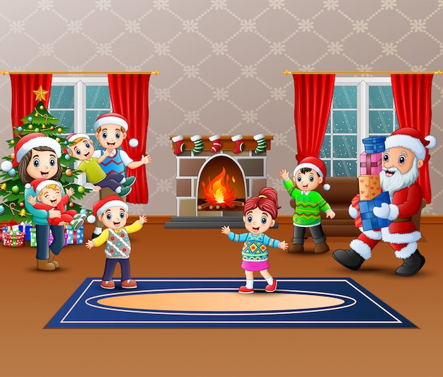 Happy santa claus holding a gifts to give a family Premium Vector