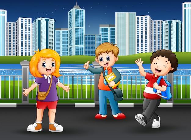 Happy school children at the city park Premium Vector
