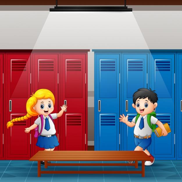 Happy school children meet in the locker room Premium Vector