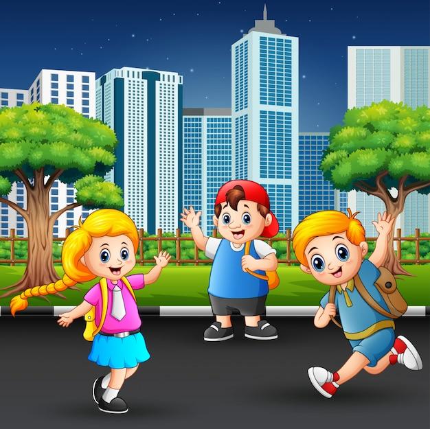 Happy school children walking on the city road Premium Vector