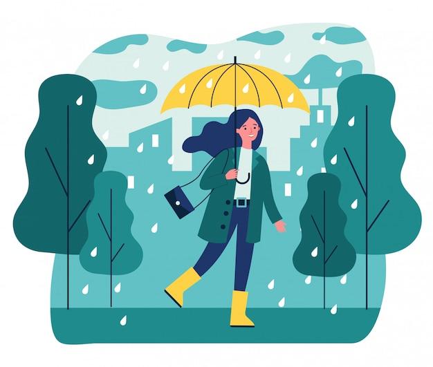 Счастливая усмехаясь девушка с зонтиком гуляя в дождливый день Premium векторы