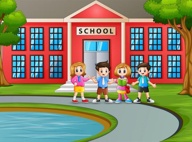 Happy student in front the school building Premium Vector