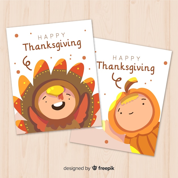 Happy thanksgiving card collection in flat design with cute kinds in fancy costume Free Vector