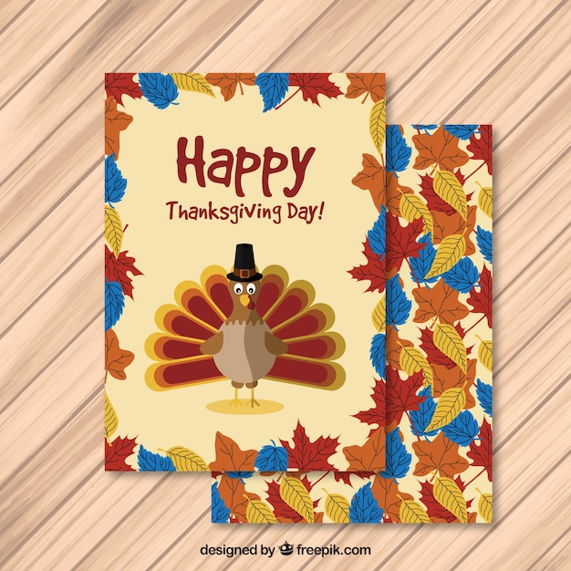 Happy thanksgiving card with a turkey and\ leaves