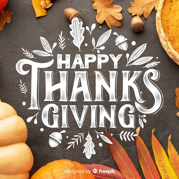 Happy thanksgiving lettering on black background Free Vector