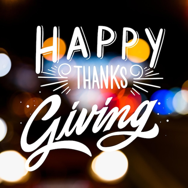 Happy thanksgiving lettering on blurred background Free Vector
