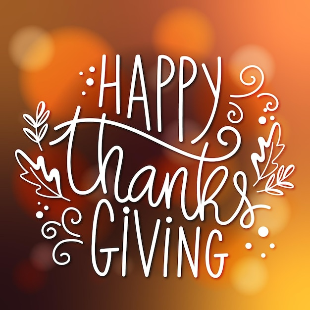 Happy thanksgiving lettering on blurred background Premium Vector