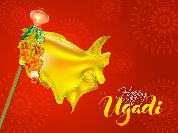 Каллиграфия happy ugadi иллюстрация с бамбуковой палкой, желтой тканью, цветочной гирляндой, листьями ниима и калаш на красной мандале Premium векторы
