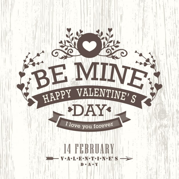 Happy valentine on a wooden background Free Vector