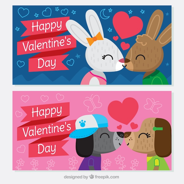 Happy valentine\'s day banners with couples of\ animals kissing