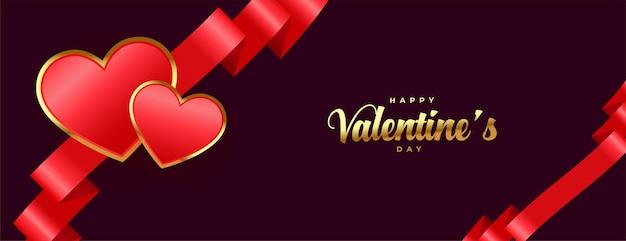 Felice banner premium di san valentino con nastro e cuori Vettore gratuito
