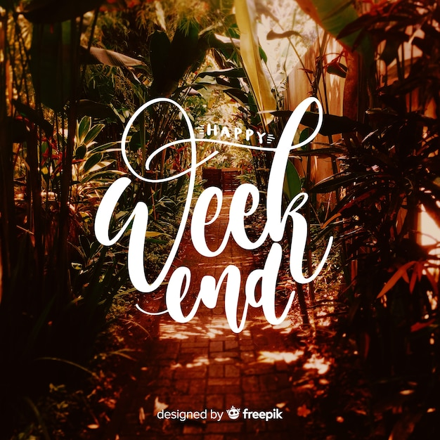 Happy weekend lettering with photography background Free Vector