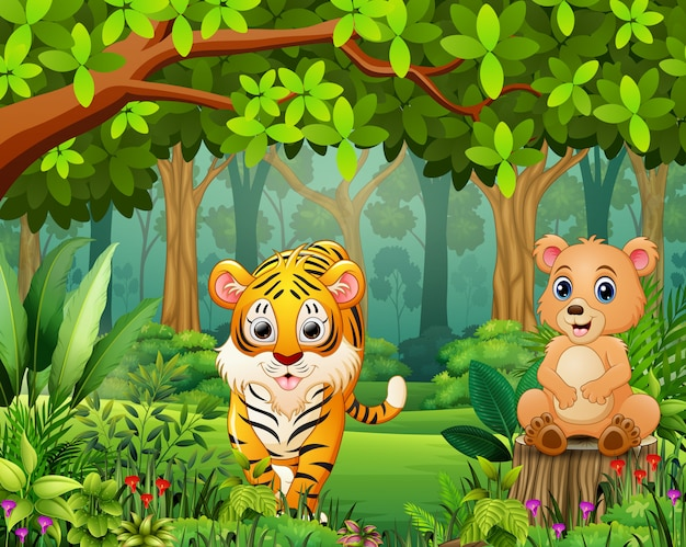 Happy wild animal cartoon in a beautiful green forest Premium Vector