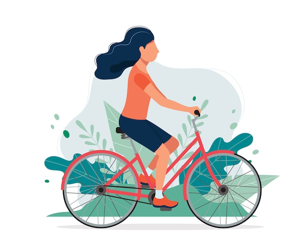 Happy woman with a bike in the park. Premium Vector