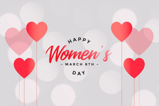 Happy womens day hearts and bokeh background Free Vector