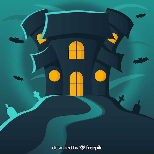 Haunted halloween house with bats and cemetery background in flat design Free Vector