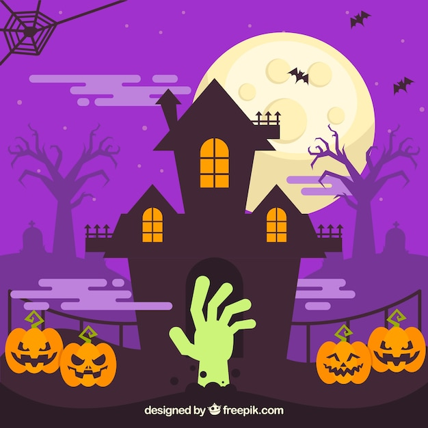 Haunted house background with pumpkins and zombie hand