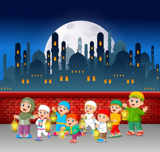 He children are walking and holding the ramadan lantern near the red wall Premium Vector