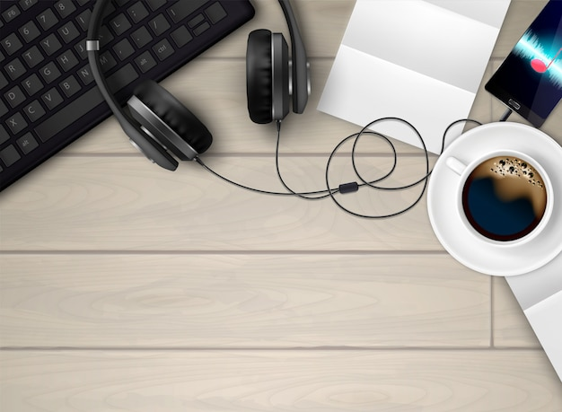 Headphones earphones realistic conceptual composition with top view of workspace with coffee keyboard and music player illustration Free Vector