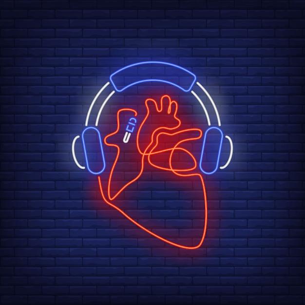 Cuffie e cuore realizzati con cavo al neon Vettore gratuito