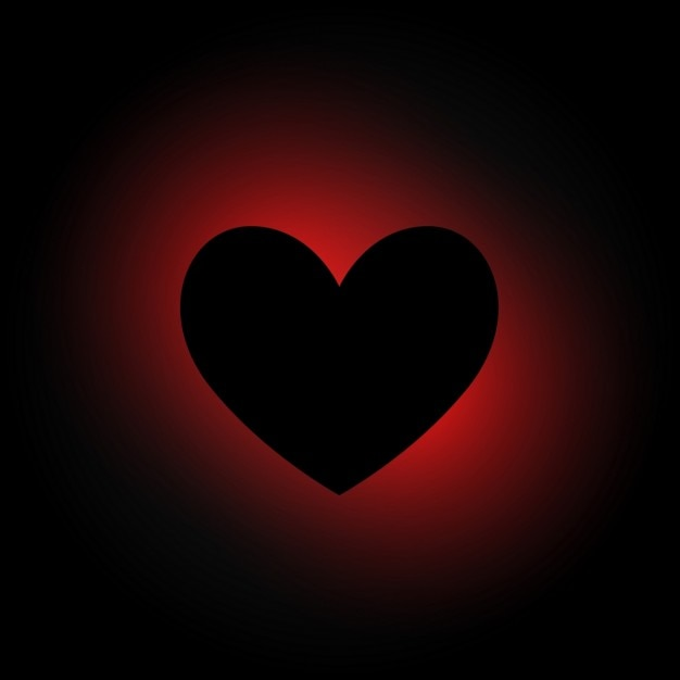Heart in dark background Vector | Free Download