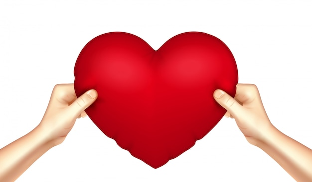 Heart pillow in hands realistic Free Vector